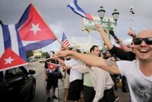 People celebrate the death of Fidel Castro in the streets of Little Havana on Nov. 26, 2016. Randy Vazquez, Sun-Sentinel