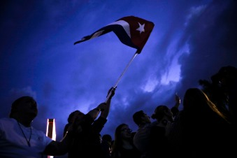 People celebrate the death of Fidel Castro in the streets of Little Havana on Nov. 26, 2016. Randy Vazquez, Sun-Sentinel