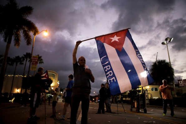 Hernan Reyes waves a Cuban flag on Satuday morning. Reyes was one of many people who celebrated the death of Fidel Castro in the streets of Little Havana on Nov. 26, 2016. Reyes described that day as the happiest day of his life. Randy Vazquez, Sun-Sentinel