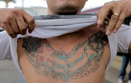 Noel Martinez shows his tattoo of the Cuban flag on Saturday. Martinez joined the people celebrating the death of Fidel Castro in the streets of Little Havana on Nov. 26, 2016. Randy Vazquez, Sun-Sentinel