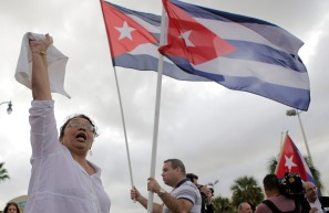 Maria Garrido, speaks to the crowd of people that gathered on Eight Street in Little Havana on Nov. 26, 2016. Garrido joined the crowd of people celebrating the death of Fidel Castro. Randy Vazquez, Sun-Sentinel