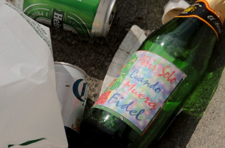 "An empty bottle on Eight Street in Little Havana that says ""open only when Fidel dies"". Randy Vazquez, Sun-Sentinel"