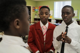 Some students at Forest Park Elementary in Boynton Beach are learning to be gracious young men during the Gentleman's Club, which meets after school every other Tuesday. Zoe Augustine, center, wore his red jacket to the meeting this Tuesday. Randy Vazquez, Sun-Sentinel