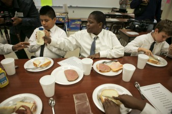 Some students at Forest Park Elementary in Boynton Beach are learning to be gracious young men during the Gentleman's Club, which meets after school every other Tuesday. From left, Brayan Benitez, Medelson Charles, and Ayden Davis practice their table etiquette. Randy Vazquez, Sun-Sentinel