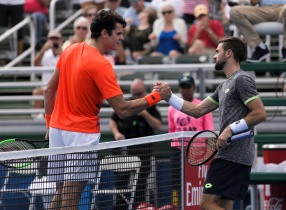Milos Raonic, left, and Tim Smyczek, right, greet each other after their match at the Delray Beach Open at the Delray Beach Tennis Center on Tuesday, Feb. 21, 2017. Raonic would go on to win the match 6-1 and 6-4. Randy Vazquez, South Florida Sun-Sentinel