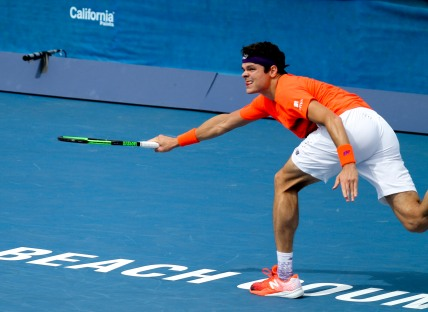 Milos Raonic reaches for a ball hit by Tim Smyczek during the Delray Beach Open at the Delray Beach Tennis Center on Tuesday, Feb. 21, 2017. Randy Vazquez, South Florida Sun-Sentinel