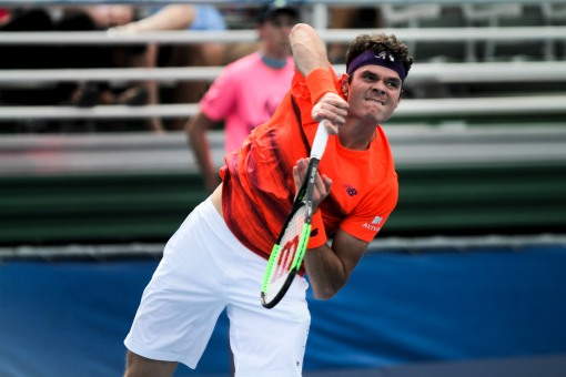 Milos Raonic serves during the Delray Beach Open at the Delray Beach Tennis Center on Tuesday, Feb. 21, 2017. Randy Vazquez, South Florida Sun-Sentinel