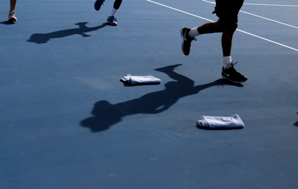 Ball boys and girls run around the court at the Delray Beach Open at the Delray Beach Tennis Center on Tuesday, Feb. 21, 2017. Randy Vazquez, South Florida Sun-Sentinel
