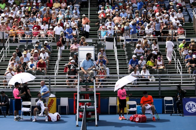 Tim Smyczek, left, and Milos Raonic, right,during their match at the Delray Beach Open at the Delray Beach Tennis Center on Tuesday, Feb. 21, 2017. Randy Vazquez, South Florida Sun-Sentinel