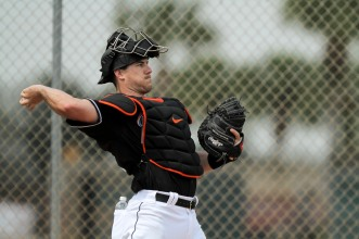 Miami Marlins pitchers and catchers began spring training Tuesday at Roger Dean Stadium in Jupiter. Catcher J.T. Realmuto (11) throws a pitch during training. Other positions groups also showed up to workout. Randy Vazquez, South Florida Sun-Sentinel