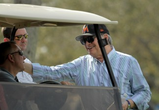 Miami Marlins pitchers and catchers began spring training Tuesday at Roger Dean Stadium in Jupiter. Team owner Jeffrey Loria, right, smiles during training. Randy Vazquez, South Florida Sun-Sentinel