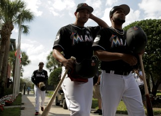 Miami Marlins pitchers and catchers began spring training Tuesday at Roger Dean Stadium in Jupiter. Pitchers Severino Gonzalez (48), left, and Odrisamer Despaigne (43), right walk out to the practice field. Other positions groups also showed up to workout. Randy Vazquez, South Florida Sun-Sentinel