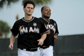 Miami Marlins pitchers and catchers began spring training Tuesday at Roger Dean Stadium in Jupiter. Pitchers Jeff Locke (31), left, and Edinson Volquez (36), right, run after a pitching session. Randy Vazquez, South Florida Sun-Sentinel