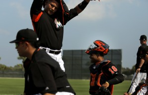 Miami Marlins pitchers and catchers began spring training Tuesday at Roger Dean Stadium in Jupiter. Catcher Tomas Telis (18) smiles before some catching drills. Other positions groups also showed up to workout. Randy Vazquez, South Florida Sun-Sentinel
