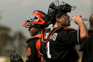 Miami Marlins pitchers and catchers began spring training Tuesday at Roger Dean Stadium in Jupiter. Catchers J.T. Realmuto (11), right, and Tomas Telis (18), left, during some catching drills. Other positions groups also showed up to workout. Randy Vazquez, South Florida Sun-Sentinel