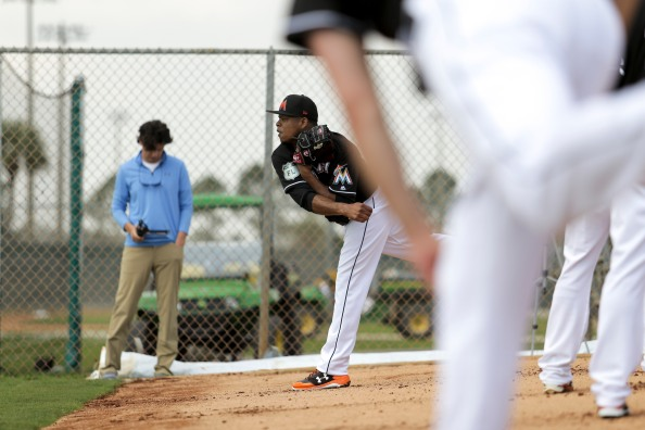 Miami Marlins pitchers and catchers began spring training Tuesday at Roger Dean Stadium in Jupiter. Pitcher Edinson Volquez throws some pitches during the first day of training. Other positions groups also showed up to workout. Randy Vazquez, South Florida Sun-Sentinel