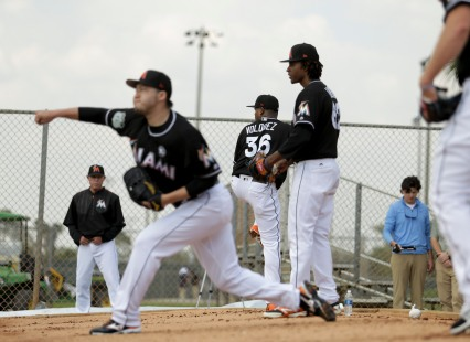 Miami Marlins pitchers and catchers began spring training Tuesday at Roger Dean Stadium in Jupiter. From left, pitchers Junichi Tazawa (25), Edinson Volquez (36), and Jose Ureña throw some pitches during training. Other positions groups also showed up to workout. Randy Vazquez, South Florida Sun-Sentinel