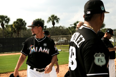 Miami Marlins pitchers and catchers began spring training Tuesday at Roger Dean Stadium in Jupiter. Pitchers Nick Wittgren (64), left, and Severino Gonzalez (48), during practice. Other positions groups also showed up to workout. Randy Vazquez, South Florida Sun-Sentinel