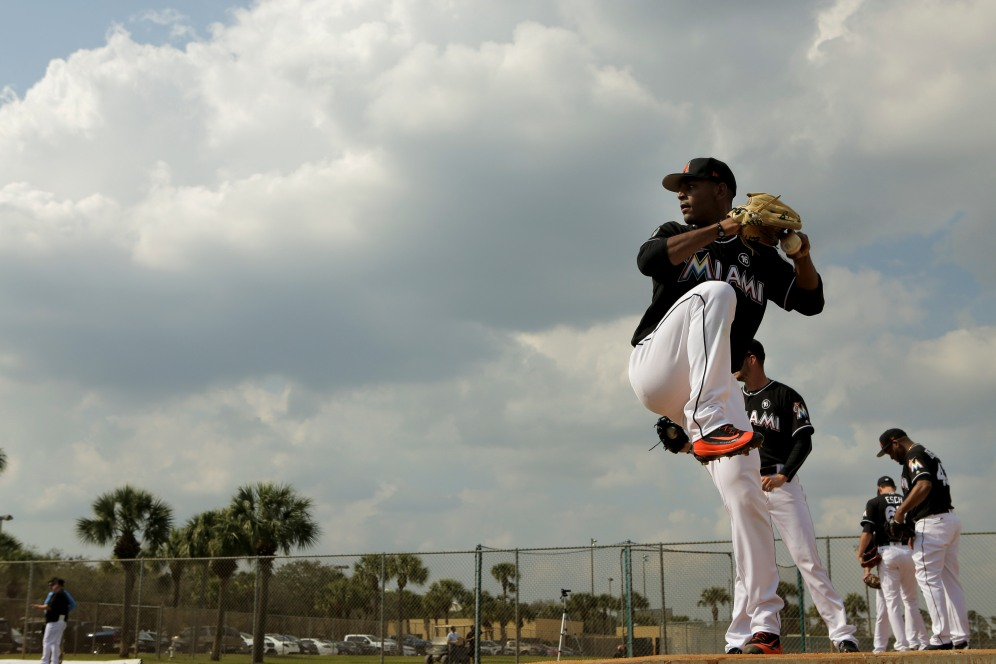 Miami Marlins pitchers and catchers began spring training Tuesday at Roger Dean Stadium in Jupiter. Pitcher Jarlin Garcia (66) throws a pitch during training. Other positions groups also showed up to workout. Randy Vazquez, South Florida Sun-Sentinel
