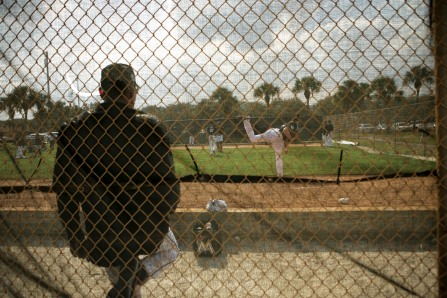 Miami Marlins pitchers and catchers began spring training Tuesday at Roger Dean Stadium in Jupiter. Kyle Lobstein (53), right, throws a pitch during training. Other positions groups also showed up to workout. Randy Vazquez, South Florida Sun-Sentinel