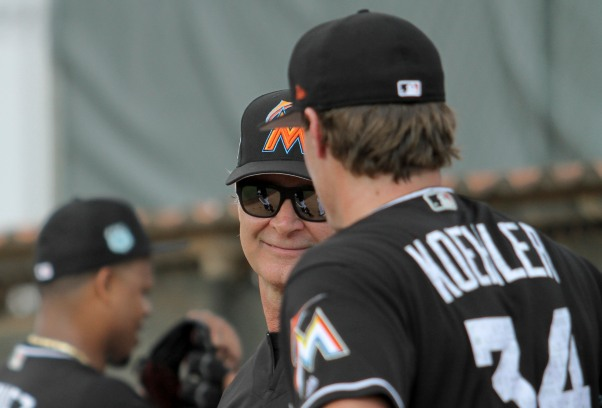Miami Marlins pitchers and catchers began spring training Tuesday at Roger Dean Stadium in Jupiter. Manager Don Mattingly, left, and pitcher Tom Koehler (34), right, talk during training. Randy Vazquez, South Florida Sun-Sentinel