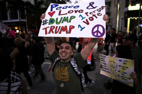 Over a hundred people protested against newly elected president Donald Trump in the streets of Wilton Manors Saturday. This is one of many protest that have occurred across the country since Trump won the presidential election earlier this month. Randy Vazquez, Sun-Sentinel.