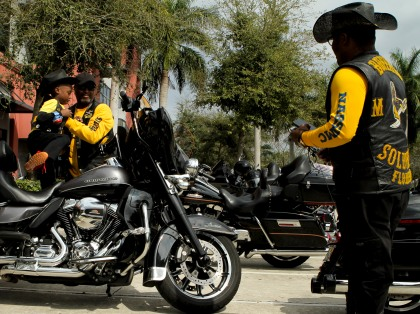 Members of the Buffalo Soldiers Motorcycle Club Miami Chapter volunteer in the community, discuss history, and ride their bikes all over the country. The group is named after the black soldiers in the US Army's 9th and 10th Calvary units that fought against Native Americans on the western frontier after the Civil War. The members meet once a month to discuss topics related to the club and make history personations. Nasir Severe, left, gets helped off a motorcycle as his dad Syd Severe, right, looks on Saturday in Sunrise during the clubs monthly meeting. Randy Vazquez, South Florida Sun-Sentinel