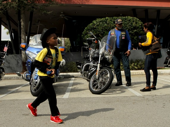 Members of the Buffalo Soldiers Motorcycle Club Miami Chapter volunteer in the community, discuss history, and ride their bikes all over the country. The group is named after the black soldiers in the US Army's 9th and 10th Calvary units that fought against Native Americans on the western frontier after the Civil War. The members meet once a month to discuss topics related to the club and make history personations. Nasir Severe, 7, left, walks past a row of motorcycles on Saturday in Sunrise during the clubs monthly meeting. Randy Vazquez, South Florida Sun-Sentinel