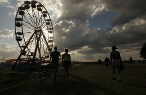 People begin to pour in to the Okeechobee Music and Art Festival on Thursday. Randy Vazquez, South Florida Sun-Sentinel