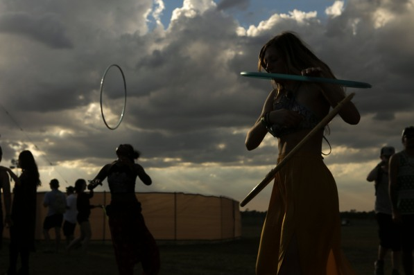 Kemba Douglas, left, and Lauren Smith, right, hula-hoop at Okeechobee Music and Art Festival on Thursday. Randy Vazquez, South Florida Sun-Sentinel