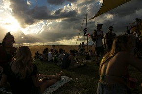 People listen to a band play at Okeechobee Music and Art Festival on Thursday. Randy Vazquez, South Florida Sun-Sentinel