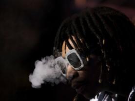 Wiz Khalifa blows smoke during his performance at Okeechobee Music and Art Festival Friday night. Randy Vazquez, SouthFlorida.com
