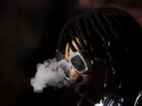 Wiz Khalifa blows smoke during his performance at Okeechobee Music and Art Festival Friday night. Randy Vazquez, SouthFlorida.com