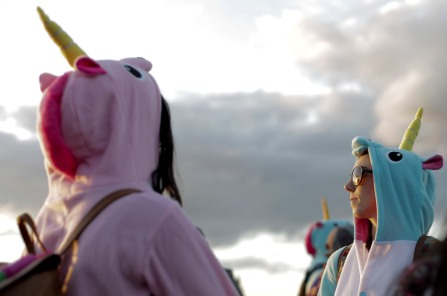 Erin Wright, right, dresses as a unicorn at Okeechobee Music and Arts Festival on Saturday afternoon. Randy Vazquez, SouthFlorida.com