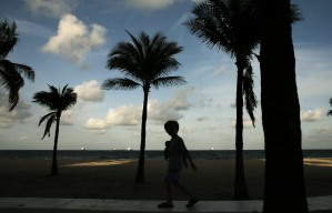 A silhouette of Jack Ducey, walking on a small ledge at Fort Lauderdale Beach on April 18, 2017. Randy Vazquez, South Florida Sun-Sentinel