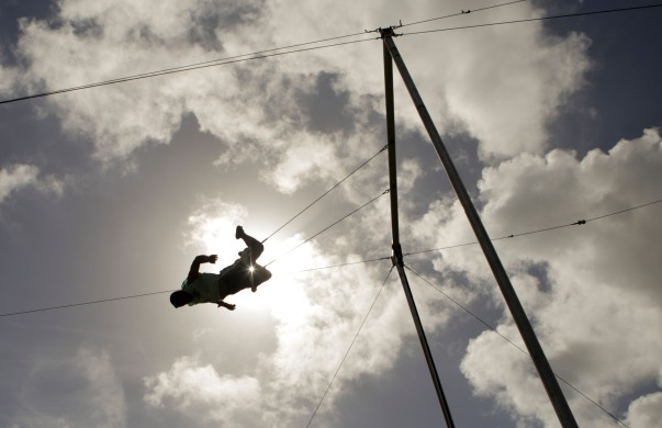Marcos Santos swings during a trapeze activity at the Levis Jewish Community Center Marleen Forkas Summer Camp in Boca Raton on Tuesday, June 20, 2017. Randy Vazquez, South Florida Sun-Sentinel