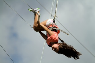 Alivia Stein, 8, swings upside down during a trapeze activity at the Levis Jewish Community Center Marleen Forkas Summer Camp in Boca Raton on Tuesday, June 20, 2017. Randy Vazquez, South Florida Sun-Sentinel