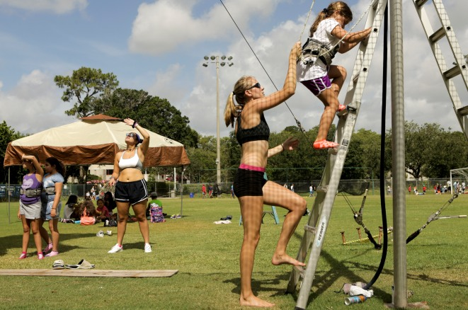 Kristi Fowler, center, helps a kid off a ladder during a trapeze activity at the Levis Jewish Community Center Marleen Forkas Summer Camp in Boca Raton on Tuesday, June 20, 2017. Randy Vazquez, South Florida Sun-Sentinel