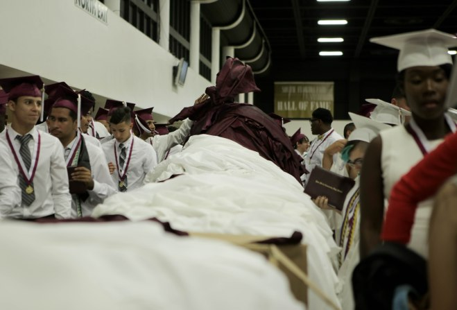Students return their gowns after the Lake Worth Community High School graduation at the Expo Center in the South Florida Fairgrounds in West Palm Beach on Friday, May 19, 2017. Randy Vazquez South Florida Sun-Sentinel