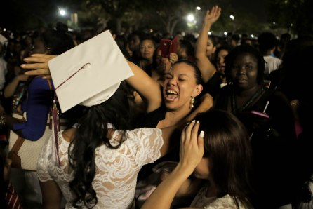A student is received with a hug after the Lake Worth Community High School graduation at the Expo Center in the South Florida Fairgrounds in West Palm Beach on Friday, May 19, 2017. Randy Vazquez South Florida Sun-Sentinel