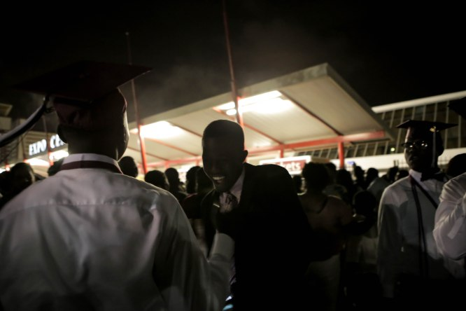 Students shake hands after graduating from Lake Worth Community High School at the Expo Center in the South Florida Fairgrounds in West Palm Beach on Friday, May 19, 2017. Randy Vazquez South Florida Sun-Sentinel