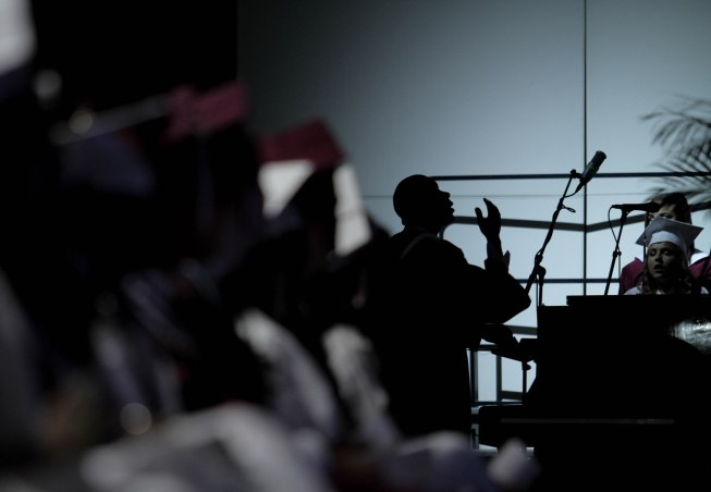A man is silhouetted during a performance during the Lake Worth Community High School graduation at the Expo Center in the South Florida Fairgrounds in West Palm Beach on Friday, May 19, 2017. Randy Vazquez South Florida Sun-Sentinel