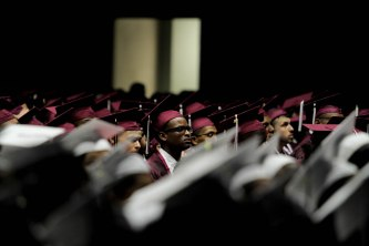 Students listen to speeches during the Lake Worth Community High School graduation at the Expo Center in the South Florida Fairgrounds in West Palm Beach on Friday, May 19, 2017. Randy Vazquez South Florida Sun-Sentinel