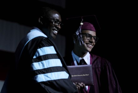 A student receives his diploma during the Lake Worth Community High School graduation at the Expo Center in the South Florida Fairgrounds in West Palm Beach on Friday, May 19, 2017. Randy Vazquez South Florida Sun-Sentinel