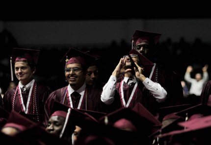 Students celebrate after receiving their diplomas during the Lake Worth Community High School graduation at the Expo Center in the South Florida Fairgrounds in West Palm Beach on Friday, May 19, 2017. Randy Vazquez South Florida Sun-Sentinel