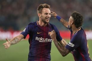 Barcelona's Ivan Rakitic, left, and Neymar, right, celebrate after Rakitic scores the second goal of the match Saturday night versus rival Real Madrid at Hard Rock Stadium. Randy Vazquez, South Florida Sun-Sentinel