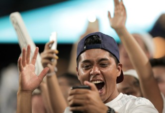 Fans celebrate after Real Madrid's first goal during Saturday night's match versus rival Barcelona. Randy Vazquez, South Florida Sun-Sentinel