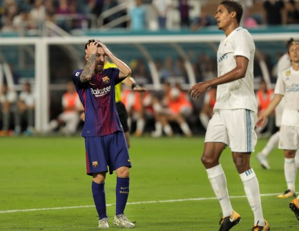 Barcelona's Lionel Messi, left, grabs his head in frustration after missing a scoring opportunity Saturday versus rival Real Madrid at Hard Rock Stadium. Randy Vazquez, South Florida Sun-Sentinel