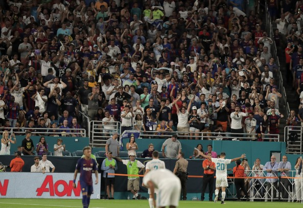 Real Madrid's Marco Asensio, right, celebrates after scoring the tying goal against rival Barcelona on Saturday night at Hard Rock Stadium. Randy Vazquez, South Florida Sun-Sentinel