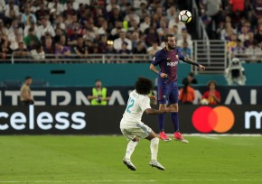 Barcelona defender Alex Vidal, right, leaps over Real Madrid defender Marcelo, left, to head the ball Saturday night at Hard Rock Stadium. Randy Vazquez, South Florida Sun-Sentinel